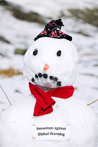Snowman with sign protesting against global warming, Wrynose Pass, Lake District, England,  UK. March.  -  Ashley Cooper