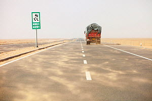 Dust storm blowing sand across highway in Inner Mongolia during severe drought, China, March 2009.  -  Ashley Cooper