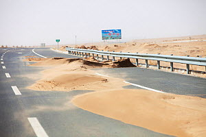 Sand dunes spreading across highway during severe drought,  Inner Mongolia, China. March 2009.  -  Ashley Cooper
