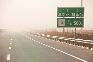 Dust storm sweeping across highway in Inner Mongolia during severe drought, China, March 2009.  -  Ashley Cooper