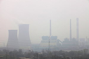 Smog  over coal fired power plants, Shanxi Province, China. March 2009. In 2008 China officially became the worlds largest emitter of greenhouse gases. - Ashley Cooper