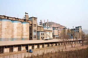 Coal fired cement factory billows smoke, Tongshuan, Shanxi Province, China. March 2009. In 2008 China officially became the worlds largest emitter of greenhouse gases. - Ashley Cooper