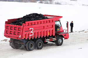 Trucks hauling low grade coal from an open cast coal mine near Heihe, Heilongjiang province, China, March 2009. In 2008 china became the worlds largest emitter of greenhouse gases. - Ashley Cooper