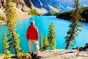 Man looking out over Moraine Lake in the  Banff National Park, Alberta, Canada, August 2012. - Ashley Cooper