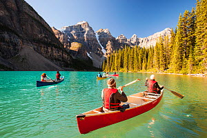 People in canoes on Moraine Lake in the Canadian Rockies, Banff National Park, Canadian Rockies, Alberta, August 2012. - Ashley Cooper