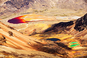 Colourful lakes below the peak of Chacaltaya, lake discoloured by mine effluent., Andes, Bolivia. October 2015. - Ashley Cooper