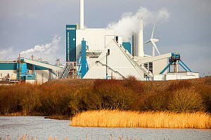 The new biofuel power plant at the Iggesund paper board manufacturer in Workington, Cumbria, UK with wind turbines behind. When commissioned the power station will fuel the plant as well as feeding po... - Ashley Cooper