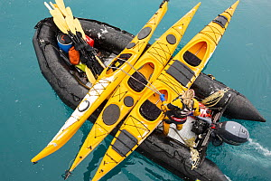 Zodiacs and sea kayaks being lifted off the deck of an expedition cruise ship onto the water, off South Georgia, Antarctica.  -  Ashley Cooper