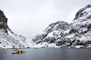 Tourists from expedition cruise to Antarctica sea kayaking in Larson Harbour, Drygalski Fjord, South Georgia, Antarctica, February 2014. - Ashley Cooper