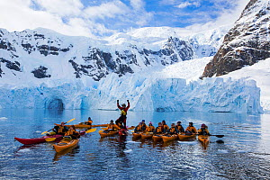Members of an expedition cruise to Antarctica sea kayaking in Paradise Bay beneath Mount Walker, Antarctic Peninsula. February 2014. - Ashley Cooper