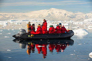 Members of an expedition cruise to Antarctica in a Zodiac in Fournier Bay, Gerlache Strait, Antarctic Peninsula.  -  Ashley Cooper
