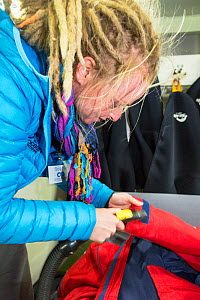 Passengers undergoing bio-security checks on the Akademik Sergey Vavilov  to remove any stray seeds or biological material that might contaminate Antarctica. - Ashley Cooper
