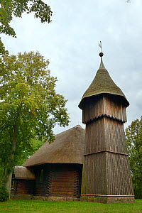 Old wooden church and belfry with thatched roofs from Masuria, now within the Ethnographic Park, Olsztynek, Poland, September 2017. - Nick Upton