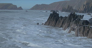 Aerial view of waves breaking on rocks on a beach at high tide, Pembrokeshire, Wales, UK, January 2017.  -  Five Films