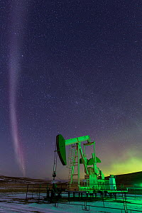 Proton Arc  -  a rare red band of light in the aurora, with an oil pump. Alberta, Canada, March 2017. - Felis Images