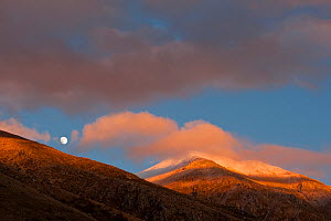 Moon rising over Mount Velino at sunset, in the Sirente-Velino Nature Reserve. Central Apennines, Abruzzo, Italy.  -  Bruno D'Amicis