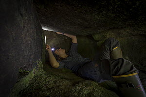 Photographer and ecologist Jen Guyton working in a cave. Gorongosa National Park, Mozambique - Naskrecki & Guyton