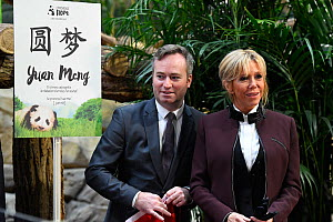 Jean-Baptiste Lemoyne, French Junior Minister for Foreign Affairs and Brigitte Macron, wife of the French president in front of the panel with the name of the panda cub at naming ceremony of the 4-mon...  -  Eric Baccega