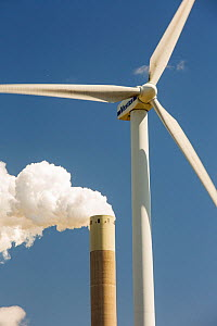 Wind turbine with stacks of coal fired power station in Amsterdam, Netherlands. May 2013  -  Ashley Cooper