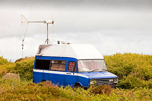 Camper van with a wind turbine used to power a computer and other electrical equipment near Zennor, Cornwall, UK. June 2010 - Ashley Cooper