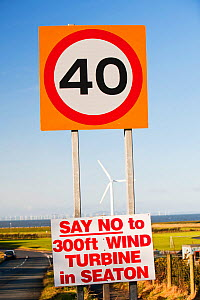 Protest sign about a new wind turbine in Seaton near Workington, Cumbria, England, UK. With onshore wind turbines and the offshore Robin Rigg wind farm visible. January 2012 - Ashley Cooper