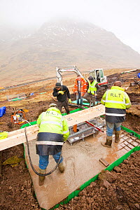 Cement being pumped into the foundations in initial groundworks for 3 wind turbines, Kirkstone Pass, Lake District, England, UK.  February 2012.  -  Ashley Cooper
