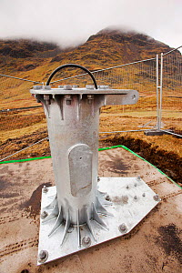 Base section bolted to the foundations in initial groundworks for 3 wind turbines, Kirkstone Pass, Lake District, England, UK.  February 2012. - Ashley Cooper