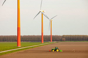 Colourful wind turbines in polders, reclaimed land near Almere, Flevoland, Netherlands. May 2013  -  Ashley Cooper