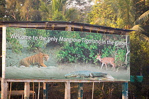 Wildlife sign for tiger mangrove reserve in the Sundarbans, Ganges, Delta, India. This area is very low lying and vulnerable to sea level rise. December 2013 - Ashley Cooper