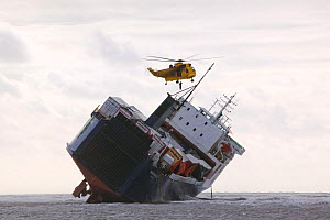 RAF 'Sea King' Helicopter preparing to drop salvage experts onto The Riverdance washed ashore off Blackpool. The Riverdance was one of 3 ships lost that day off the UK. The ship was hit by a huge wave...  -  Ashley Cooper