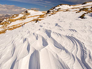 Snow shaped and scoured by a strong wind when it fell, above Wrynose Pass in the Lake District, Cumbria, UK. April 2013  -  Ashley Cooper