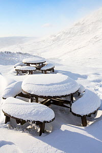Picnic tables on the summit of Kirkstone Pass, plastered in fresh snow after overnight snow storms in the Lake District, Cumbria, UK.  January 2016  -  Ashley Cooper