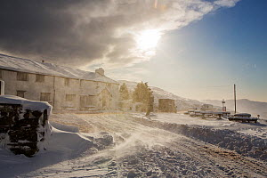 The Kirkstone Pass Inn, plastered in fresh snow after overnight snow storms and with spindrift from drifting snow in windy conditions in the Lake District, Cumbria, UK. January 2016 - Ashley Cooper