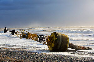 Storm Gertrude, with winds of up to 132 mph resulted in this Trinity House 'Cardinal Mark' ripped off its steel anchor chain and washed up on Walney Island. England, UK. January 2016 - Ashley Cooper