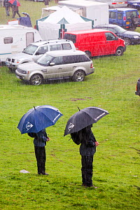 Men with umbrella  in the rain at The Vale of Rydal Sheepdog Trials, in Ambleside, Lake District, UK. August 2010  -  Ashley Cooper