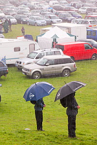 Men with umbrellas  in the rain at The Vale of Rydal Sheepdog Trials, in Ambleside, Lake District, UK. August 2010  -  Ashley Cooper