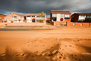 Dark clouds over Lytham St Annes with sand blown from coastal dunes during severe weather with 100 mph. Lancashire, England, UK. November 2010 - Ashley Cooper