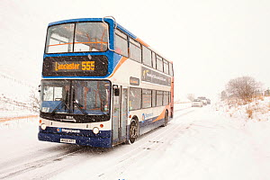 Bus on the Dunmail Raise in a blizzard, Lake District, England, UK. December 2010  -  Ashley Cooper