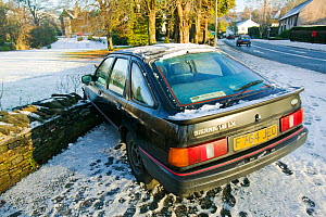 Car which skidded and crashed on ice in Ambleside in the Lake District, England, UK. December 2004  -  Ashley Cooper