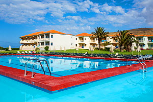 A swimming pool at a holiday complex in Skala Eresou on Lesvos, Greece. June 2013 - Ashley Cooper