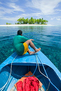 Man in boat in Funafuti Atoll, Tuvalu. MArch 2007. This area is low lying and very susceptable to sea level rise. - Ashley Cooper