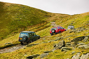 Off road vehicles on the Walna Scar road above Coniston in the Lake District, UK. November 2004  -  Ashley Cooper