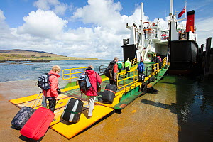 Foot passengers embark the Caledonian Macbrayne ferry, Loch Nevis, which services the Isle of Eigg from Mallaig, Scotland, UK.. May 2012 - Ashley Cooper