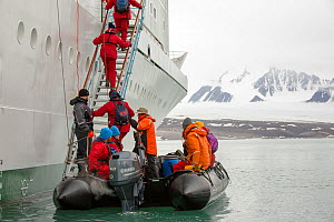 Passengers disembark Zodiaks onto the Russian research vessel, AkademiK Sergey Vavilov an ice strengthened ship on an expedition cruise to Northern Svalbard in front of a glacier. July 2013  -  Ashley Cooper
