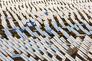 Heliostats reflecting sunlight onto solar tower at Ivanpah Solar Thermal Power Plant, the largest solar thermal plant in the world. It covers 4,000 acres of desert and produce 392 megawatts (MW) of el... - Ashley Cooper