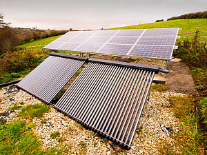 Solar photo voltaic panels and solar thermal panels providing electricity and hot water for a 16th Century farm house on Bodmin moor, Cornwall, UK. November 2012 - Ashley Cooper