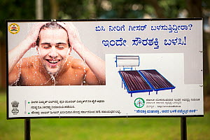 An advert for a solar water heater in  a park in Bangalore, India. December 2013  -  Ashley Cooper