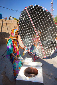 Women constructing solar cookers at the Barefoot College in Tilonia, Rajasthan, India. The Barefoot College is a worldwide charity, founded by Bunker Roy, its aims are, education, drinking water, elec...  -  Ashley Cooper