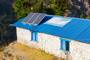 Solar photo voltaic panels on the rooftops of a school in Ladruk in the Himalayan foothills, Nepal. December 2012 - Ashley Cooper