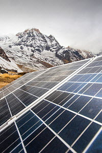 Solar photo voltaic panels powering a Guest house at Annapurna Base Camp in the Himalayas, Nepal. December 2012  -  Ashley Cooper